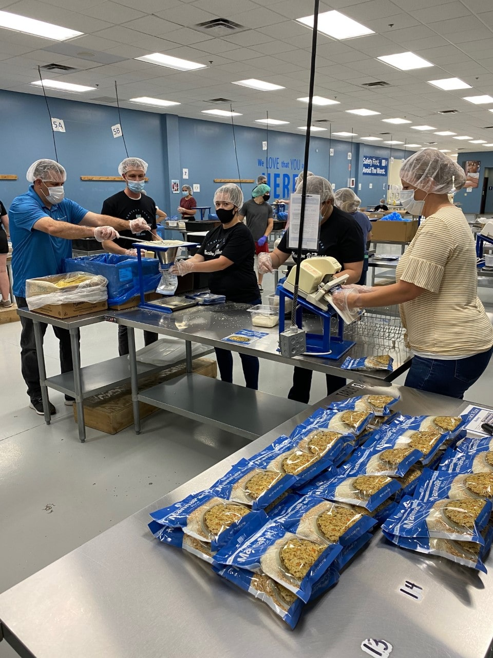 phusion wellness staff serving at feed my starving children